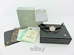 Rolex Cellini 18 kt gold ref 4112/8 box & papers full set Never Polished Top